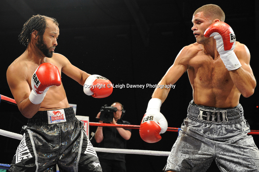Tony Hill (silver shorts) defeats Paul Samuels at Medway Park, Gillingham, Kent, UK on 13th May 2011. Frank Maloney Promotions. Photo credit © Leigh Dawney 2011.
