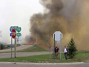 Heavy smoke and flames from a forest fire reach the southern Grayling exit on I-75 Thursday afternoon.