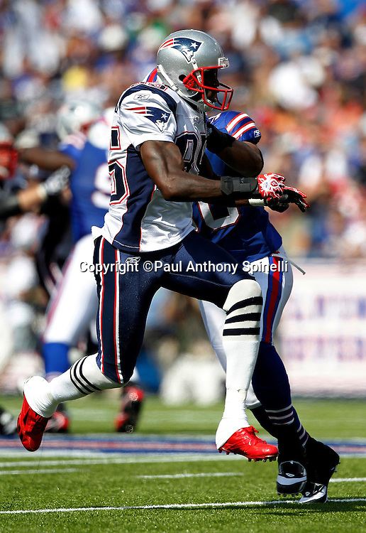 New England Patriots wide receiver Chad Ochocinco (85) gets some air as he goes out for a pass during the NFL week 3 football game against the Buffalo Bills on Sunday, September 25, 2011 in Orchard Park, New York. The Bills won the game 34-31. ©Paul Anthony Spinelli