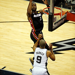 Jun 16, 2013; San Antonio, TX, USA; Miami Heat shooting guard Dwyane Wade (3) shoots against San Antonio Spurs point guard Tony Parker (9) during the first quarter of game five in the 2013 NBA Finals at the AT&T Center. Mandatory Credit: Derick E. Hingle-USA TODAY Sports