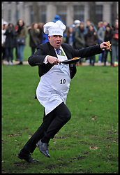 Tim Loughton MP takes part in the MP's and Lords race against political Journalist in the Rehab Parliamentary Pancake Shrove Tuesday race a charity event which sees MPs and Lords joined by media types in a race to the finish. Victoria Tower Gardens, Westminster, Tuesday February 12, 2013. Photo By Andrew Parsons / i-Images