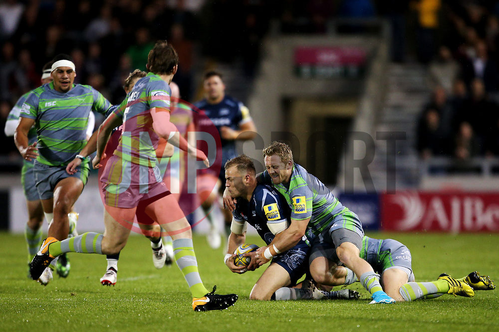 Mike Haley of Sale Sharks is tackled by Alex Tait of Newcastle Falcons - Mandatory by-line: Matt McNulty/JMP - 08/09/2017 - RUGBY - AJ Bell Stadium - Sale, England - Sale Sharks v Newcastle Falcons - Aviva Premiership