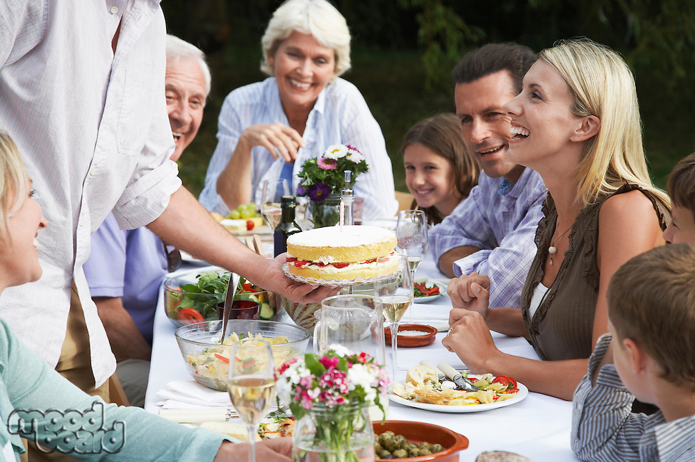 Family dining outdoors