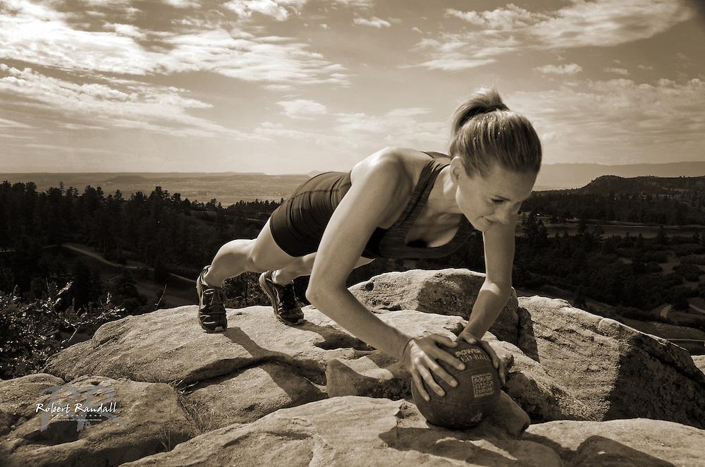 Woman doing push-ups on medicine-ball in Daniels Park in Castle Rock, CO