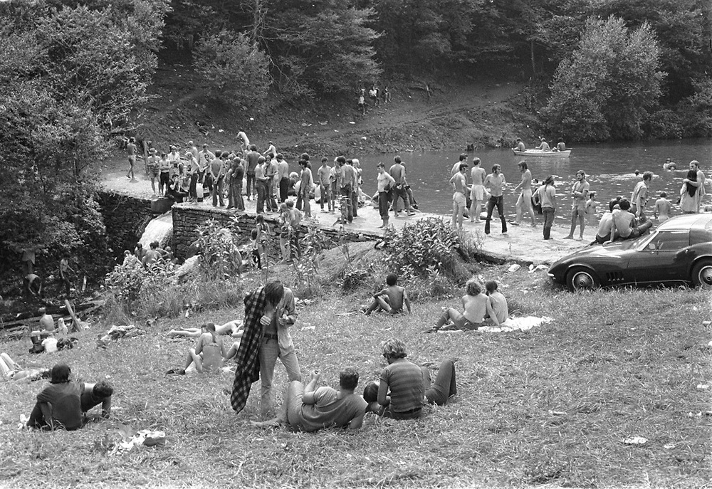 Woodstock Rock Festival fans at a pond on the farm at the Woodstock rock festival at Max Yasgur's 600 acre farm, in the rural town of Bethel, NY, on the weekend of August 16-18, 1969.