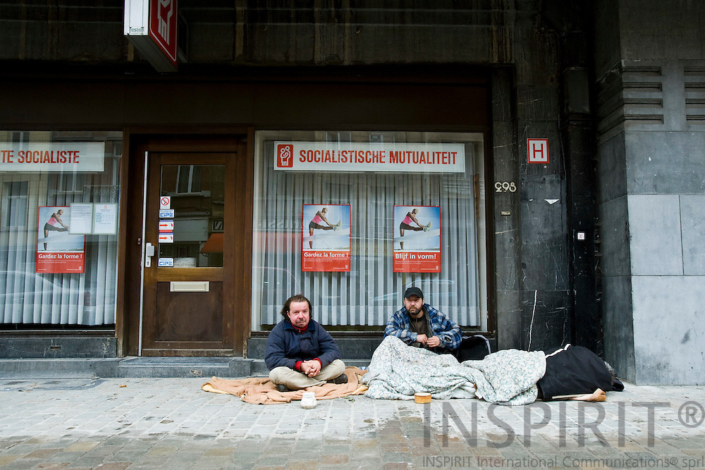 BRUSSELS - BELGIUM - 21 OCTOBER 2008 -- Homeless men camping in front of a social and sick-benefit office in Brussels waiting for people to donate money. Photo: Erik Luntang/INSPIRIT Photo.