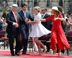 Governor General David Johnston, left to right, Prime Minister Justin Trudeau, Minister of Canadian Heritage Melanie Joly and Sophie Gregoire Trudeau dance during the noon hour entertainment during Canada Day celebrations on Parliament Hill, in Ottawa on Friday, July 1, 2016. Photo by Justin Tan/CP/ABACAPRESS.COM    553804_005 Ottawa Canada
