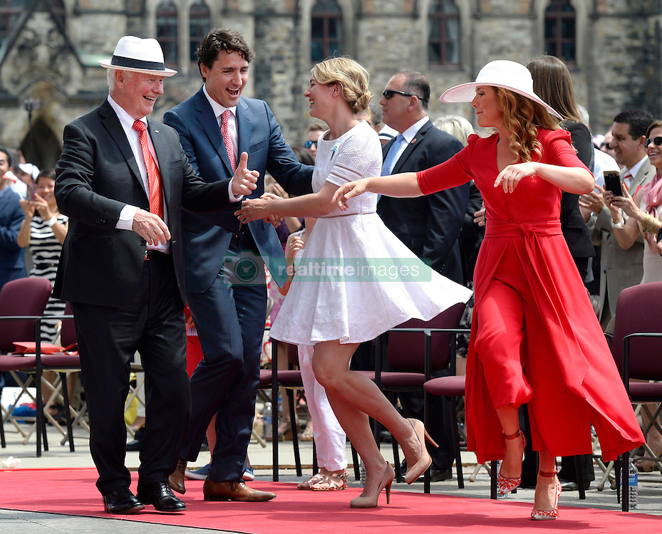 Governor General David Johnston, left to right, Prime Minister Justin Trudeau, Minister of Canadian Heritage Melanie Joly and Sophie Gregoire Trudeau dance during the noon hour entertainment during Canada Day celebrations on Parliament Hill, in Ottawa on Friday, July 1, 2016. Photo by Justin Tan/CP/ABACAPRESS.COM  | 553804_005 Ottawa Canada