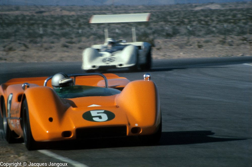 Can-Am series (Canadian-American Challenge Cup), 1967 or 1968: Denny Hulme in a McLaren ahead of a Chaparral, car designed by engineer-driver Jim Hall.