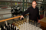 David Mazal of Englewood pours Poema Cava Brut sparkling wine during the Dayton Performing Arts Alliance Inaugural Gala at the Schuster Center in downtown Dayton, Saturday, October 5, 2013.