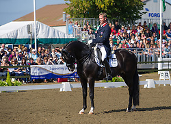 Olympic medal-winning equestrian Carl Hester performs his winning Grand Prix dressage test in front of a packed house at the British Dressage National Championships 2012, September 15th 2012. Photo by Nico Morgan/ i-Images.