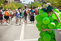 JEROME A. POLLOS/Press..Avery Strobel, 12, tries to keep his cool dressed as a bunch of grapes in the 88-degree weather.