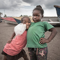 Two girls pose for the camera in Old Harbour Bay, Jamaica