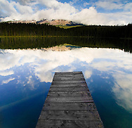 Photo Randy Vanderveen.Jasper National Park, Alberta.A dock juts out into the water of Leech Lake south of Jasper, Alberta.