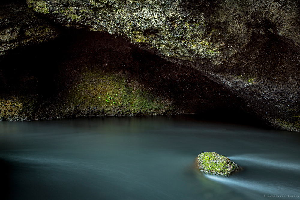 Rock in a cave stream. Iceland