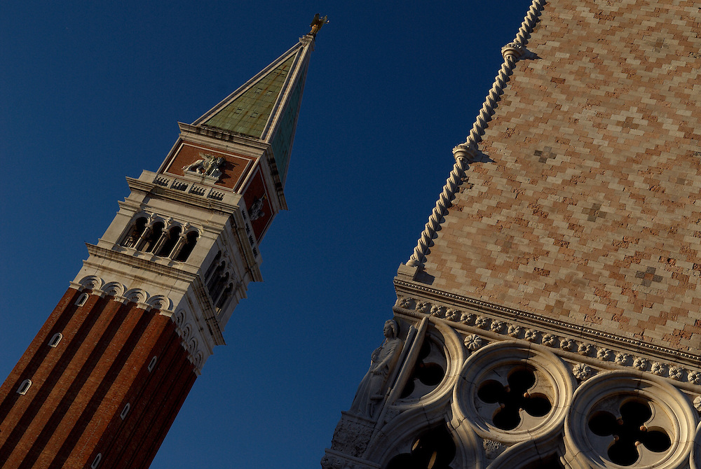 Italy, Veneto, Venice. November/12/2007...St.Mark's (San Marco) Bell Tower. Built in the 9th century the tower was originally used as a lighthouse. After falling down in 1902, the tower was rebuilt as it was, standing 12 meters wide and 98.6 meters high. ..