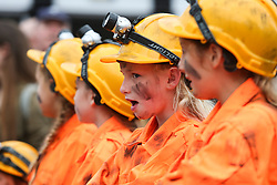 © Licensed to London News Pictures. 09/07/2016. Durham, UK. Young girls dressed as miners at the Durham Miners' Gala in County Durham, UK. The gala is a large gathering held annually associated with the coal mining heritage and trade unionism. Photo credit : Ian Hinchliffe/LNP