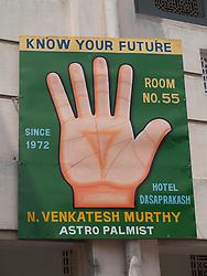 Palmistry advertisement on exterior of Hotel Dasaprakash, Mysore.