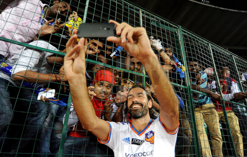 Robert Pires of FC Goa clicks a selfie with his fans after match 50 of the Hero Indian Super League between Chennaiyin FC and FC Goa held at the Jawaharlal Nehru Stadium, Chennai, India on the 5th December 2014.<br /> <br /> Photo by:  Pal Pillai/ ISL/ SPORTZPICS