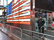 NYC, NY, USA. 19th Nov. 2015. Strategic Response Group members are stationed in midtown Manhattan, including at the U.S. Armed Forces Career Center in Times Square, the day after an ISIS propaganda video came out threatening New York City, particularly Times Square. NYC's Mayor and Police Commissioner both said there is no specific and credible threat against New York City.