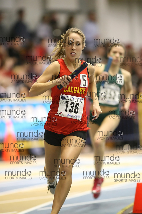 Windsor, Ontario ---13/03/09--- Heather Sim of  the University of Calgary competes in the 4x800m Relay at the CIS track and field championships in Windsor, Ontario, March 13, 2009..Sean Burges Mundo Sport Images