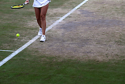 General view of the wear and tear to the grass on the baseline of court four on day eight of the Wimbledon Championships at The All England Lawn Tennis and Croquet Club, Wimbledon.