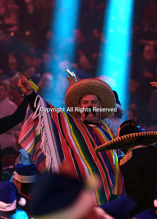 23.12.2016. Alexandra Palace, London, England. William Hill PDC World Darts Championship. A fan dressed as a Mexican sings during the match between Mervyn King and Michael Smith