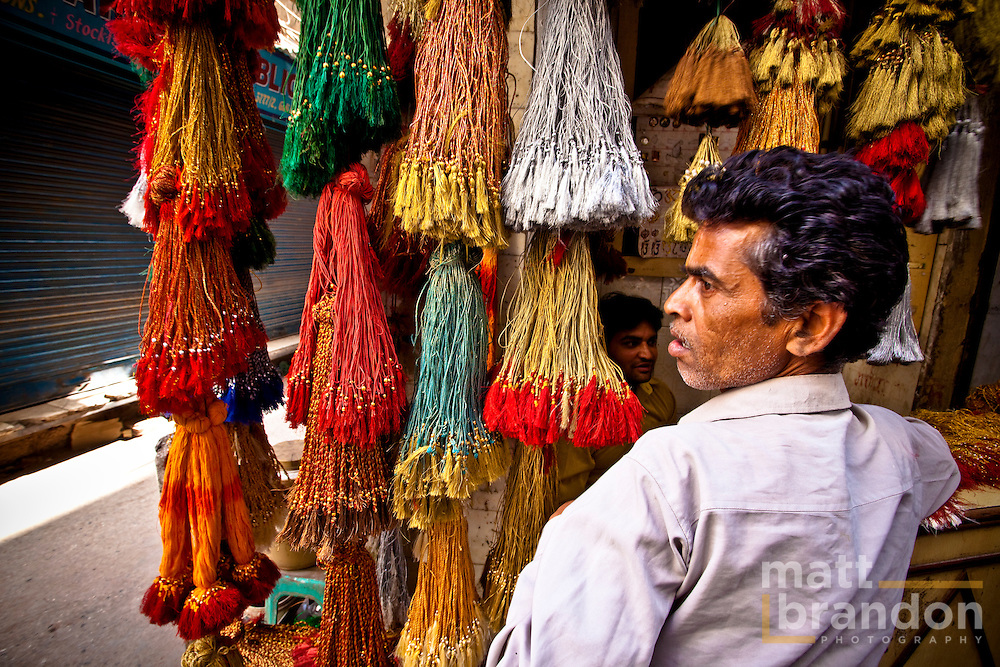 In the Chandni Chawk part of Old Delhi there manufacturers of different items. This shop sells tassels used to decorate greeting cards.