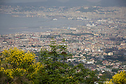 The Bay of Naples (population 3.5m) seen from the south-western slopes of the Vesuvius Volcano which last erupted in 1945.
