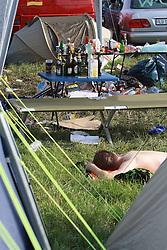 05.08.2011, Wacken, GER, W:O:A Wacken Open Air 2011, im Bild erschoepfte und muede Festivalbesucher auf dem Campingplatz in Wacken, EXPA Pictures © 2011, PhotoCredit: EXPA/ nph/  Kohring       ****** out of GER / CRO  / BEL ******