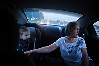 &quot;America in the Middle&quot; is a collection of images showing communities and individuals personally affected by policies but often-overlooked by politicians. |||<br /> <br /> Vi Lane reaches out to her great-grandson Thomas Brown as they drive through Platte City, Missouri. Lane lost her family's four businesses after the death of her husband 22 years ago. Her granddaugther, Thomas's mother, recently moved in with her after learning she is pregnant with her second child. The two work together to support the family, but living and medical expenses make their future uncertain.<br /> <br /> Chicago Freelance Photographer | Alyssa Schukar | Photojournalist