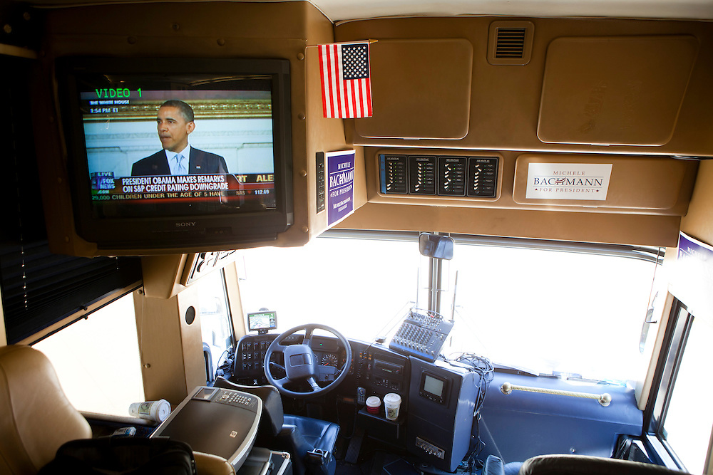 A live shot of President Barack Obama is seen on a television aboard the campaign bus of Republican presidential hopeful Michele Bachmann on Monday, August 8, 2011 in Atlantic, IA.