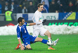 Emir Spahic of BIH vs Tim Matavz of Slovenia during friendly football match between National teams of Slovenia and Bosna and Herzegovina, on February 6, 2013 in SRC Stozice, Ljubljana, Slovenia. BIH defeated Slovenia 3-0. (Photo By Vid Ponikvar / Sportida.com)