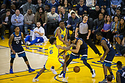 Golden State Warriors guard Nick Young (6) and Golden State Warriors forward Kevon Looney (5) battle for a loose ball against the Minnesota Timberwolves at Oracle Arena in Oakland, Calif., on January 25, 2018. (Stan Olszewski/Special to S.F. Examiner)