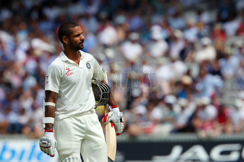 Shikhar Dhawan of India departs during day three of the 2nd Investec test match between England and India held at Lords cricket ground in London, England on the 19th July 2014<br /> <br /> Photo by Ron Gaunt / SPORTZPICS/ BCCI
