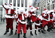 Santas hop into the holiday spirit as they deliver Candy Cane PEEPS around New York, Wednesday, Dec. 4, 2013, in New York. (Photo by Diane Bondareff/Invision for PEEPS/AP Images)