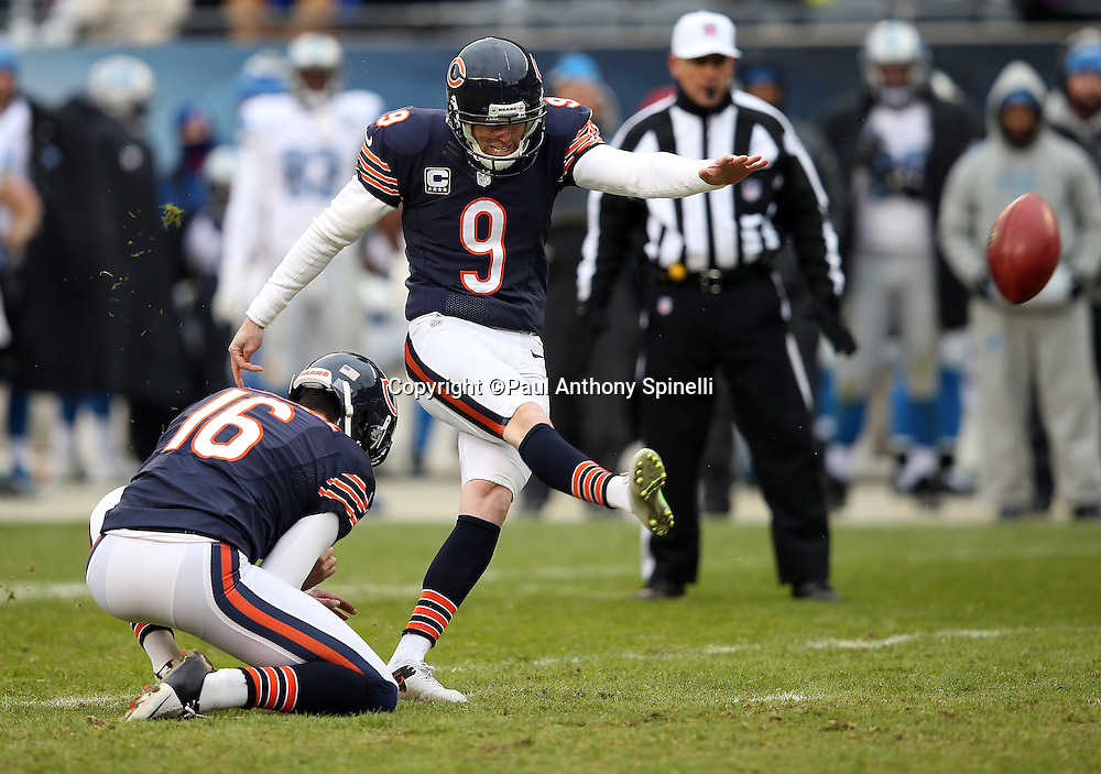 Chicago Bears punter Pat O'Donnell (16) holds while Chicago Bears kicker Robbie Gould (9) kicks a 34 yard field goal that cuts the Detroit Lions fourth quarter lead to 24-20 during the NFL week 17 regular season football game against the Detroit Lions on Sunday, Jan. 3, 2016 in Chicago. The Lions won the game 24-20. (©Paul Anthony Spinelli)