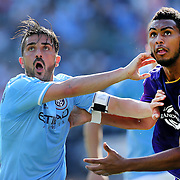 NEW YORK, NEW YORK - May 29:  David Villa #7 of New York City FC and Tommy Redding #29 of Orlando City FC challenge for position during the New York City FC Vs Orlando City, MSL regular season football match at Yankee Stadium, The Bronx, May 29, 2016 in New York City. (Photo by Tim Clayton/Corbis via Getty Images)