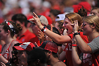 Wolfpack fans cheer as the football team takes the field the JMU game.