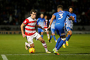 Doncaster Rovers forward John Marquis (9)  drops his shoulder and goes past Hartlepool United  defender Jake Carroll (3)  during the EFL Sky Bet League 2 match between Doncaster Rovers and Hartlepool United at the Keepmoat Stadium, Doncaster, England on 19 November 2016. Photo by Simon Davies.