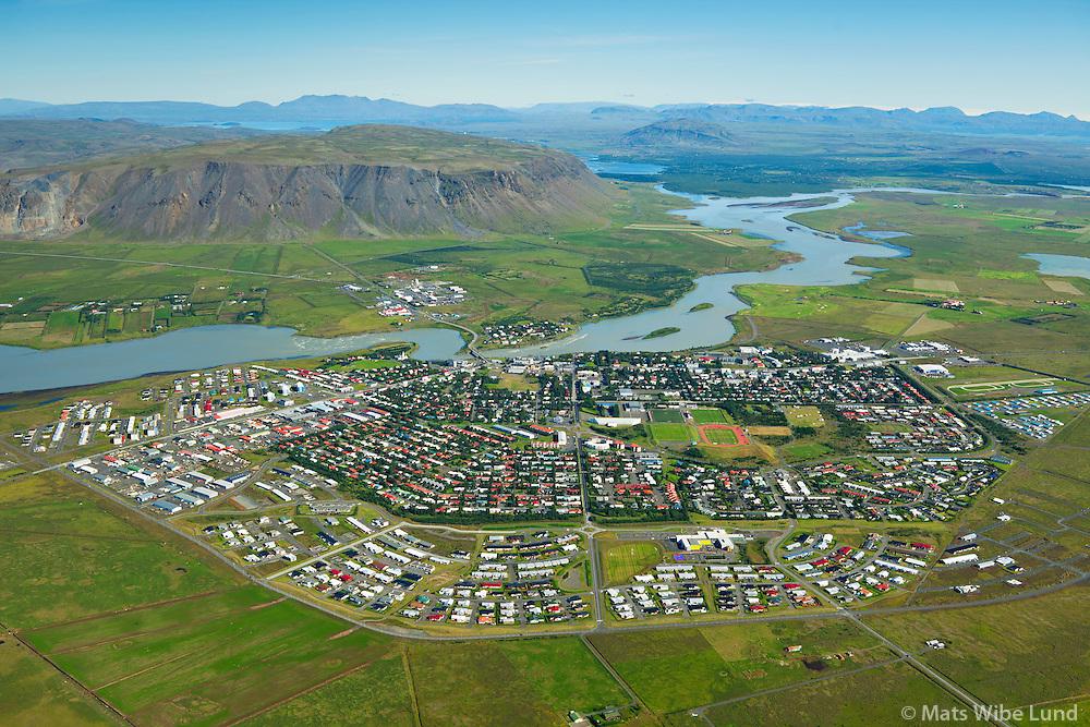 Selfoss - Ölfusá séð til norðurs, Sveitarfélagið Árborg, á/við efri hólmanum í bakgrunni getur komið stiflugerð og ný brú á hringveginum  /  Selfoss and river Olfusa viewing north. In the background is a possible site for a new bridge on mainroad nr 1 - as well as a dam for a hydroelectric power plant, Sveitarfelagid Arborg.