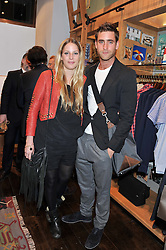 OLIVER JACKSON-COHEN and FREDERICA LOVELL-PANK at the opening of the new Jack Spade store at 83 Brewer street, London on 29th March 2012.