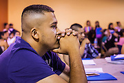 "18 AUGUST 2012 - PHOENIX, AZ:  A man prays at the beginning of a deferred action workshop in Phoenix. More than 1000 people attended a series of 90 minute workshops in Phoenix Saturday on the ""deferred action"" announced by President Obama in June. Under the plan, young people brought to the US without papers, would under certain circumstances, not be subject to deportation. The plan mirrors some aspects the DREAM Act (acronym for Development, Relief, and Education for Alien Minors), that immigration advocates have sought for years. The workshops were sponsored by No DREAM Deferred Coalition.  PHOTO BY JACK KURTZ"