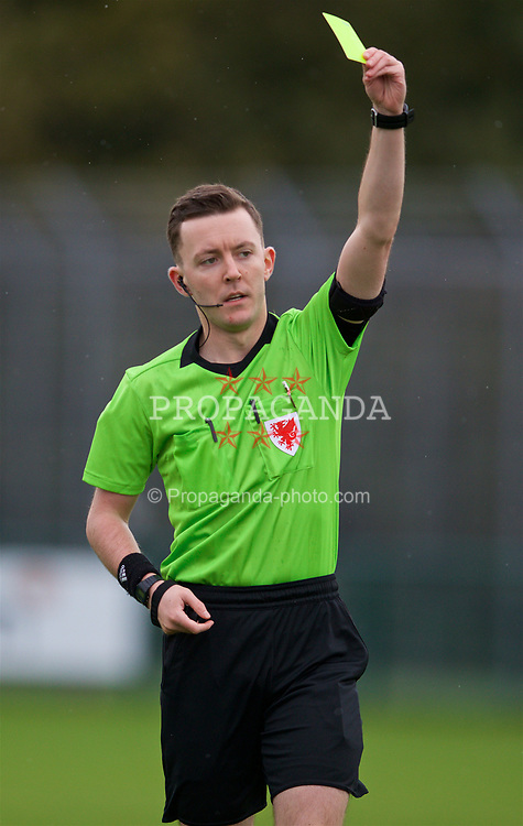 NEWPORT, WALES - Monday, October 14, 2019: Referee Jordan Harman shows a yellow card during an Under-19's International Friendly match between Wales and Austria at Dragon Park. (Pic by David Rawcliffe/Propaganda)