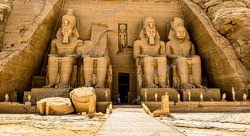 The Temple at Abu Simbel statues represent Ramesses II, seated on a throne and wearing the double crown of Upper and Lower Egypt