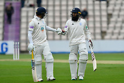 Sam Northeast of Hampshire and Hashim Amla of Hampshire walk off for lunch during the Specsavers County Champ Div 1 match between Hampshire County Cricket Club and Worcestershire County Cricket Club at the Ageas Bowl, Southampton, United Kingdom on 13 April 2018. Picture by Graham Hunt.