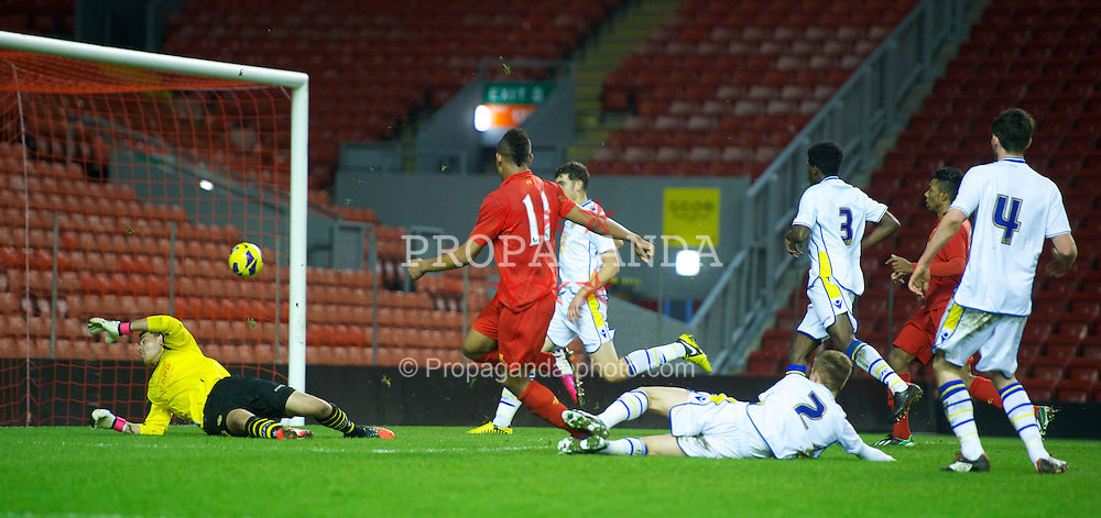 LIVERPOOL, ENGLAND - Thursday, February 28, 2013: Liverpool's Jordan Ibe scores the second goal against Leeds United during the FA Youth Cup 5th Round match at Anfield. (Pic by David Rawcliffe/Propaganda)