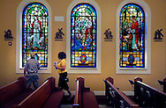 31 JULY 2011 -- IMPERIAL, Mo. -- Ronald Luaders (left) and his wife Laura Luaders inspect the stained glass windows at the new at St. John Catholic Church in rural Imperial, Mo., following the church's the Dedication Service Sunday, July 31, 2011. Stained glass windows in the new church were transferred from Holy Family Catholic Church in St. Louis, which closed in 2005. Ronald Luaders, who lives with his wife in DeSoto, is a graduate of St. John School. Photo © copyright 2011 Sid Hastings.