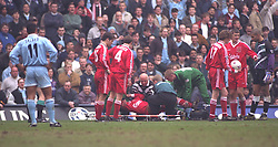 COVENTRY, ENGLAND - Saturday, April 6, 1996: Liverpool's Steve Harkness is put on a stretcher after having his leg broken by a reckless tackle from Coventry City's John Salako (left) during the Premiership match at Highfield Road. Coventry won 1-0. (Pic by David Rawcliffe/Propaganda)