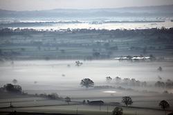 © London News Pictures. 20/01/2014. Glastonbury, UK. Mist covered countryside at Sunrise over Glastonbury Tor in Somerset on January 20, 2014.  Photo credit: Jason Bryant/LNP